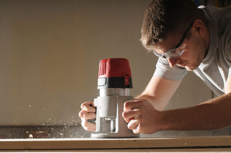 woodworker using router